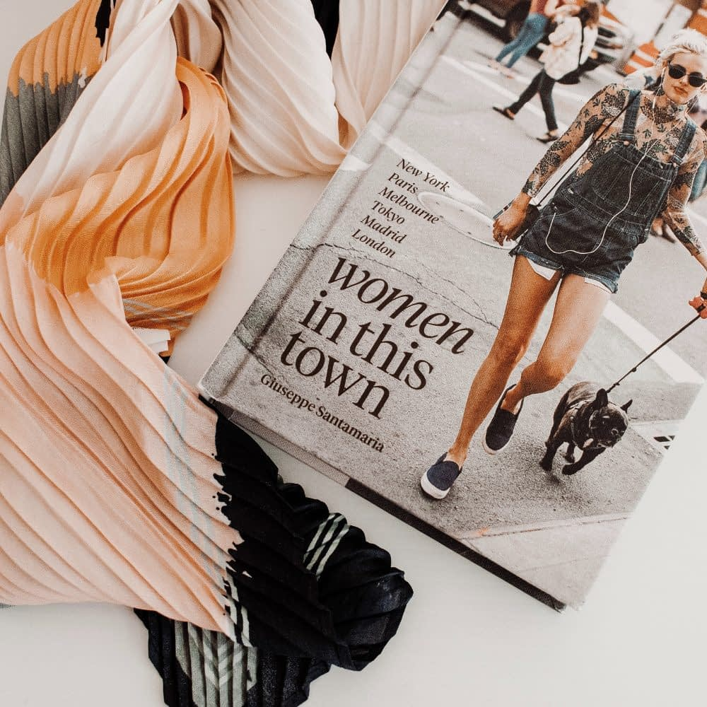 fashion coffee table book with scarves laying next to it