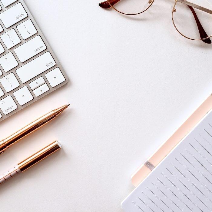 keyboard desk glasses notebook rose gold pens