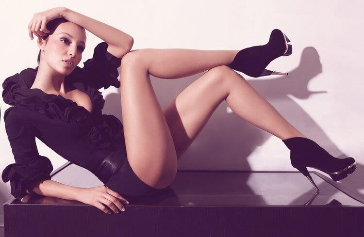 fit model linda wearing black clothing black pumps